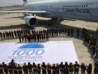 A330-300_Cathay_Pacific__1000th_A330_staff_airbus