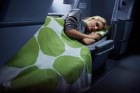 Finnair-business-woman-sleeping-01