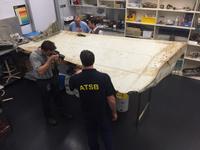 examine-piece-of-aircraft-debris-2_july2016
